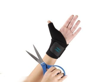 A Person wearing the Hely & Weber Trimmable Thumb support on their hand
