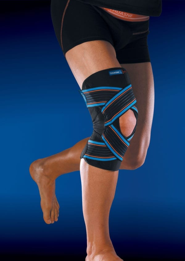 A person wearing a Thuasne Open Strapping Knee Brace