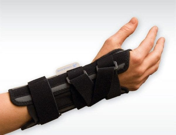 A person wearing a Thuasne Ligaflex Classic Wrist Support on their hand